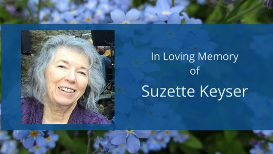 Photo of Suzette Keyser with the text In Loving Memory of Suzette Keyser