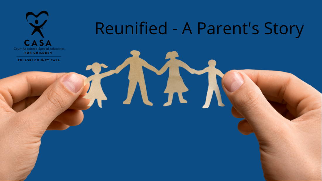 Hands holding paper cutouts of a family