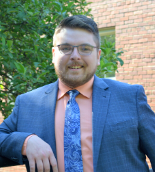 Photo of Jackson Bittner smiling while standing outside.