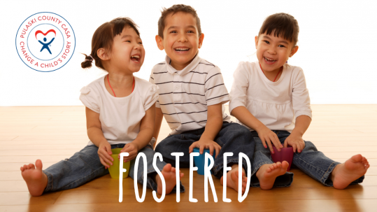 Three smiling children sitting in the floor with the text Fostered